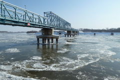 Bridge over frozen river Royalty Free Stock Photography