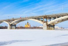 Bridge over the frozen river Oka Royalty Free Stock Photos