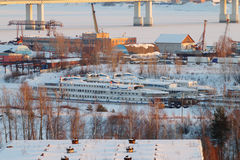 Bridge over frozen river and passenger ships Royalty Free Stock Photography