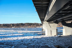 Bridge over the frozen river Stock Photography