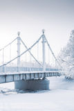 Bridge over frozen river and trees in hoarfrost. Fine art Stock Photography