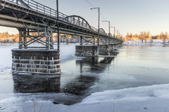 Bridge over Frozen River in Umeå, Sweden Stock Image