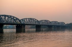 Bridge over Ganga at sunset Stock Image