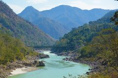 Bridge over the Ganges River in India. Bridge in Rishikesh. stock image