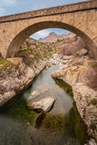 Bridge over Golo river with Mount Albanu in distance Royalty Free Stock Image