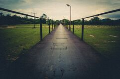 Bridge over green field Royalty Free Stock Photography