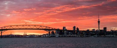 Auckland Harbour Bridge Sunrise. Bridge  over the harbour of Auckland with a wonderful clouded sunrise Royalty Free Stock Photos