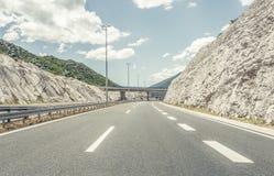 Bridge over a highway. Stock Photos