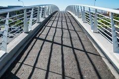 Bridge over highway. Modern metalic bridge leading above highway Stock Photography