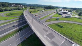 Bridge over the highway. Small bridge over the highway with a gas station and a lot of cars stock video footage