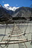 Bridge Over Hunza River. Primitive bridge suspended over Hunza river in Karakorum royalty free stock image
