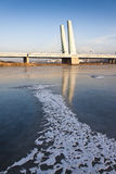 A bridge over an ice-covered river. JInzhou, northeast China Royalty Free Stock Images
