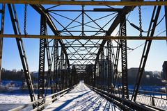 Bridge over the Icy River Royalty Free Stock Photo