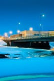 Bridge Over Icy River 1. Nocturnal view of the bridge crossing the icy river Pyhajoki in the Northern Finland stock photography