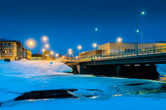 Bridge Over Icy River 2. Nocturnal view of the bridge crossing the icy river Pyhajoki in the Northern Finland royalty free stock photography