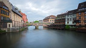 Bridge over the Ill. A corner of Petite France in Strasbourg with bridge over the placid waters of the river Ill Stock Images