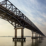 Bridge over the Irrawaddy River - Myanmar (Burma). A bridge over the Irrawaddy River (Ayeyarwaddy River) in Myanmar (Burma).  It is the countrys largest river Stock Images