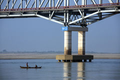 Irrawaddy River - Myanmar (Burma). Bridge over the Irrawaddy River (Ayeyarwaddy River) in Myanmar (Burma).  It is the countrys largest river and most important Royalty Free Stock Images