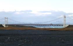 Bridge over the Jokulsarlon Glacier Lagoon and black sand beach Royalty Free Stock Photo