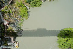 Bridge over Kawarau River. Shadow of the Kawarau Bridge, world's first bungy location Royalty Free Stock Photos
