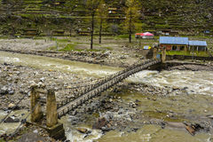 Bridge over Kunhar River in Naran Kaghan Valley, Pakistan. Naran & Kaghan are the most beautiful towns in Pakistan. Thousands of tourists travel here to see Stock Photography