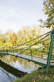 Bridge over lake in autumn Royalty Free Stock Image
