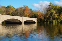 Bridge over Lake carnegie in Princeton, NJ in the fall Royalty Free Stock Image