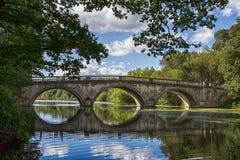 Bridge over a Lake during Day Time Stock Photos