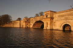 Bridge over the lake at dusk stock photography
