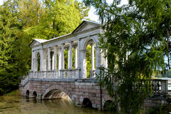 The bridge over the lake of the forest. Photo of the bridge made September day in forest Park in Pushkin Stock Photography