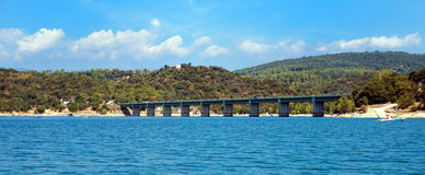 Bridge over Lake St Cassien in the South of France with beautiful blue sky and water. Royalty Free Stock Images