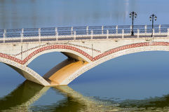 The bridge over the lake Stock Photography