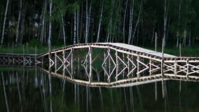 The bridge over the lake of the woods Royalty Free Stock Image