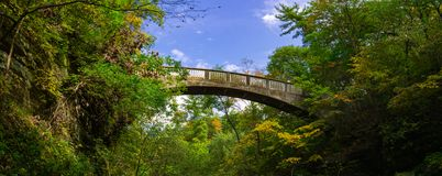 Bridge over the Lower Dells. Concrete bridge over the Lower Dells with beautiful blue skies.  Matthiessen State Park, Illinois, USA Royalty Free Stock Photo