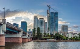 Bridge over Main River and Frankfurt Skyrscrapers in Summer Stock Photography