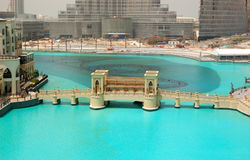 The bridge over man-made lake in Dubai downton Royalty Free Stock Photos