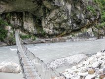 Bridge over Marsyangdi river near Tal village - Nepal Royalty Free Stock Image