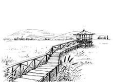 Bridge over meadow to the watchtower Royalty Free Stock Photography