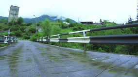 Bridge over mountain river. Mountain river and the bridge across it in the mountainous part of Georgia's Upper Svaneti stock footage