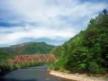 Bridge over a mountain river. Royalty Free Stock Images