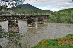 Bridge over the mountain river. Royalty Free Stock Images