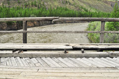 Bridge over the mountain river. Royalty Free Stock Image