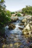 Bridge over mountain river. Royalty Free Stock Photo