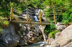 Bridge over a mountain river Stock Photo