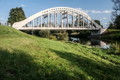 Bridge over Olse river in Karvina - Darkov in Czech republic. Most Sokolovskych hrdinu concrete bridge withOlse river bellow  in Karvina - Darkov in Czech Royalty Free Stock Images