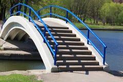Bridge over pond. With handhold Stock Photos