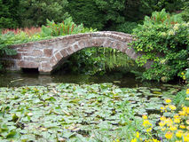 Bridge over pond Stock Images