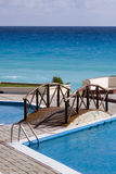 Bridge over the pool. Swimming pool at a beach-front condo Stock Photo