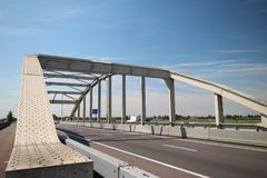 Bridge over the railway tracks at Moordrecht in motorway A20 in the Netherlands.  royalty free stock image