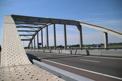 Bridge over the railway tracks at Moordrecht in motorway A20 in the Netherlands. Bridge over the railway tracks at Moordrecht in motorway A20 in the Netherlands royalty free stock photo